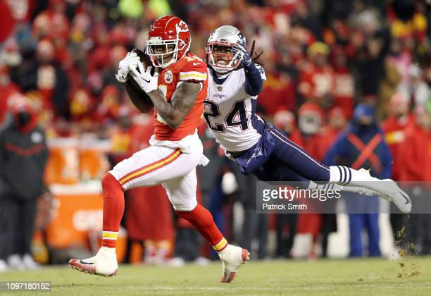 Sammy Watkins of the Kansas City Chiefs catches a pass against Stephon Gilmore of the New England Patriots in the third quarter during the AFC...