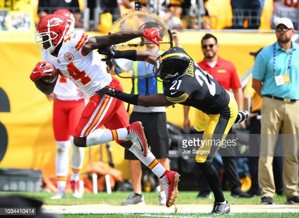 Sammy Watkins of the Kansas City Chiefs runs upfield after a catch as Sean Davis of the Pittsburgh Steelers attempts a tackle in the first quarter...