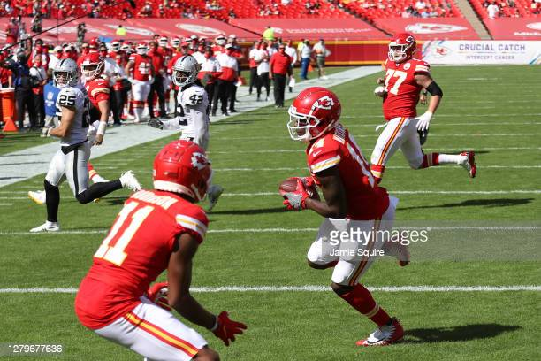 Sammy Watkins of the Kansas City Chiefs scores a touchdown reception against the Las Vegas Raiders during the second quarter at Arrowhead Stadium on...