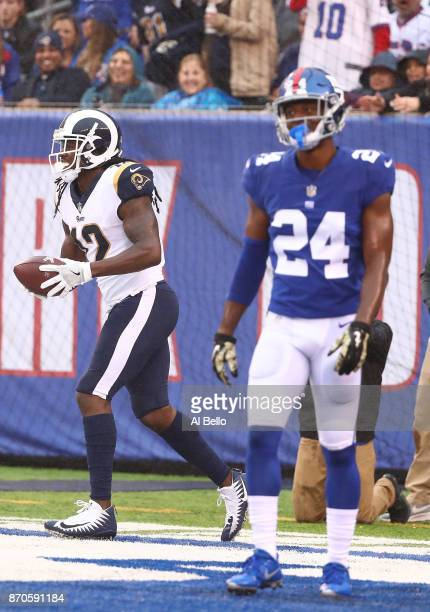 Sammy Watkins of the Los Angeles Rams celebrates scoring a touchdown as Eli Apple of the New York Giants looks on in the second quarter during their...