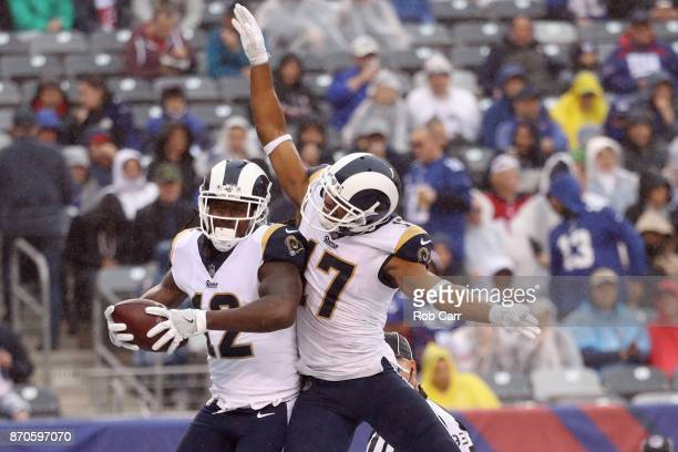 Sammy Watkins of the Los Angeles Rams celebrates scoring a touchdown with Robert Woods against the New York Giants in the first half at MetLife...