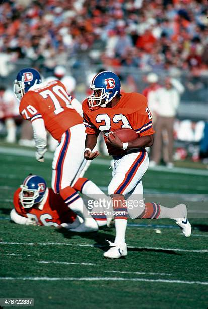 Sammy Winder of the Denver Broncos carries the ball against the Kansas City Chiefs during an NFL football game October 30 1983 at Mile High Stadium...