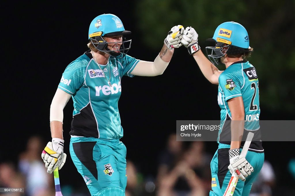 Sammy-Jo Johnson and JessJonassen of the Heat celebrate winning the Women's Big Bash League match between the Brisbane Heat and the Melbourne Stars at Harrup Park on January 12, 2018 in Mackay, Australia.
