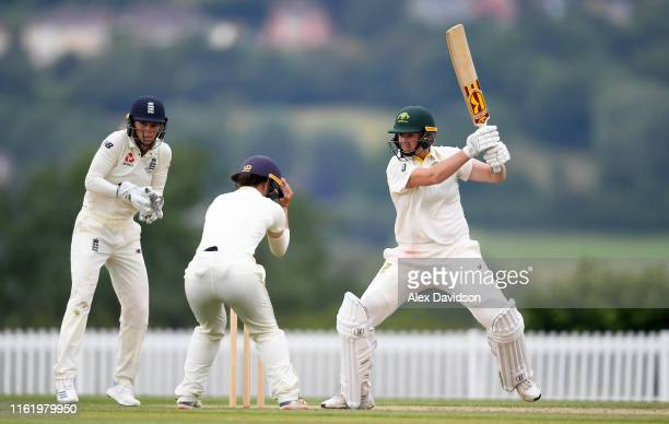 Sammy-Jo Johnson of Australia bats as Amy Jones of England looks on during Day Three of the International Friendly match between England Women and...