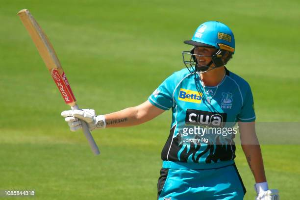 Sammy-Jo Johnson of the Heat acknowledges her half century during the Women's Big Bash League match between the Sydney Sixers and the Brisbane Heat...
