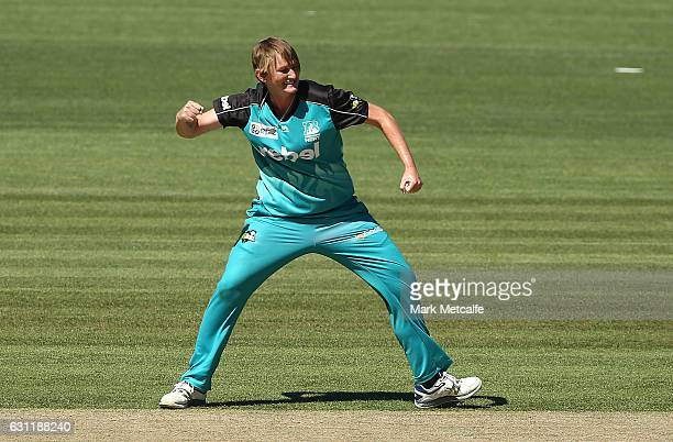 Sammy-Jo Johnson of the Heat celebrates taking the wicket of Heather Knight of the Hurricances during the Women's Big Bash League match between the...