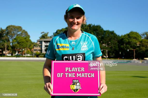 Sammy-Jo Johnson of the Heat poses with the Player of the Match sign after the Women's Big Bash League match between the Sydney Sixers and the...
