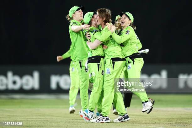 Sammy-Jo Johnson of the Thunder celebrates dismissing Laura Kimmince of the Heat with team mates and winning the Women's Big Bash League WBBL Semi...