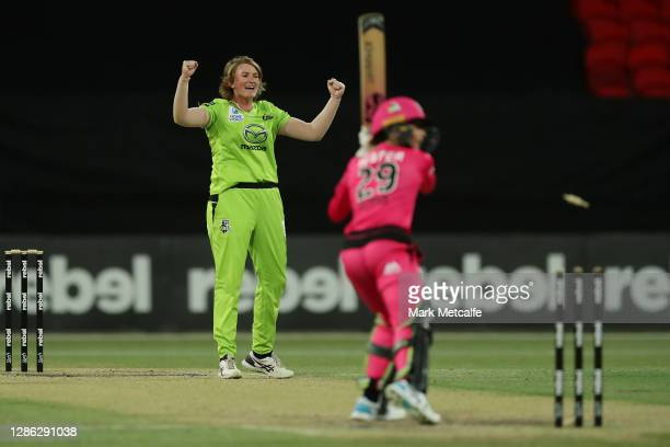 Sammy-Jo Johnson of the Thunder celebrates taking the wicket of Erin Burns of the Sixers during the Women's Big Bash League WBBL match between the...