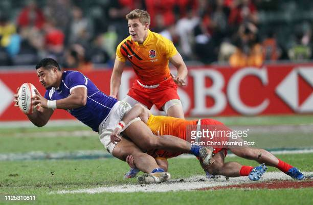 ONLY*** Samoa Alafoti Faosiliva in action while England Tom Mitchell eyeing at the Pool A match Samoa vs England second day of the Cathay Pacific/...
