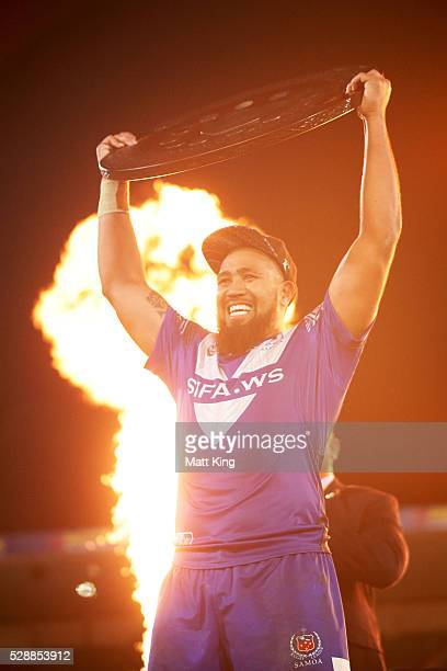 Samoa captain Frank Pritchard celebrates and lifts the Pacific Test trophy after the International Rugby League Test match between Tonga and Samoa at...
