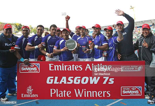 Samoa celebrate with the Plate after defeating Wales during day two of the IRB Glasgow Sevens at Scotstoun Stadium on May 6 2012 in Glasgow Scotland