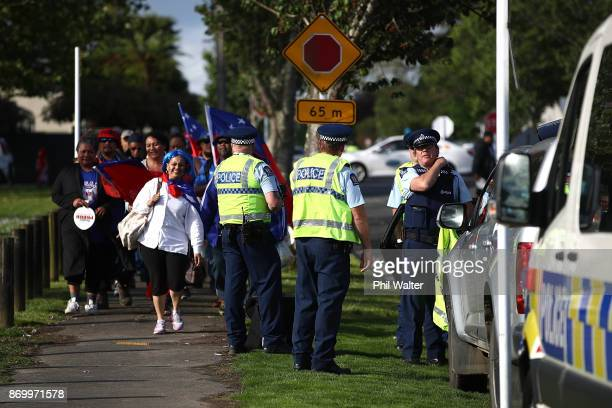 Samoa fans walk past a police presence before the 2017 Rugby League World Cup match between Samoa and Tonga at Waikato Stadium on November 4 2017 in...