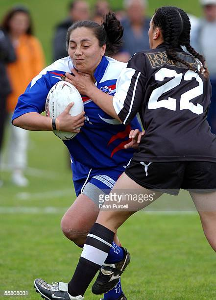 Samoa player Stephanie Lafaele crashes into Kally Leota during the 2002 Womens Rugby League World Cup match between the Kiwi Ferns and Samoa played...