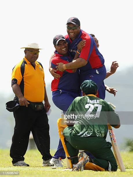 Samoa players celebrate a wicket against the Cook Islands during the ICC East Asia Pacific Division 2 tournament held at the Garden Ovals on April...