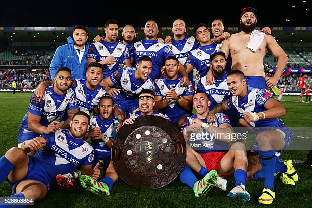Samoa pose and celebrate with the Pacific Test trophy after the International Rugby League Test match between Tonga and Samoa at Pirtek Stadium on...