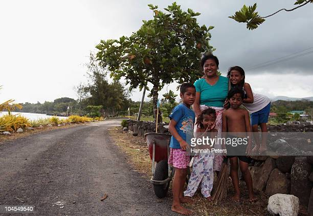 Samoan family help clean up in the village of Poutasi on September 28 2010 in Apia Samoa 189 people were killed and hundreds more injured in Samoa...
