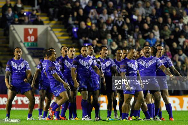 Samoan players perform the Siva Tau before the Rugby League World Cup Group B match between New Zealand and Samoa at the Halliwell Jones Stadium on...