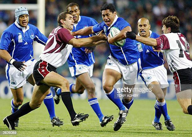 Samoan winger Dominic Feaunati crashes through the pack during their Pool C Rugby World Cup match between Samoan and Georgia at Subiaco Oval in...