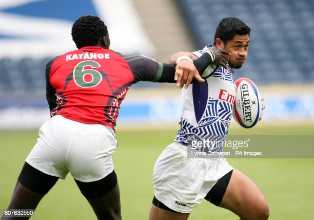 Samoa's Alafoti Fa'osiliva hands off Kenya's Humphrey Kayange during the Edinburgh Sevens Weekend at Murrayfield Edinburgh
