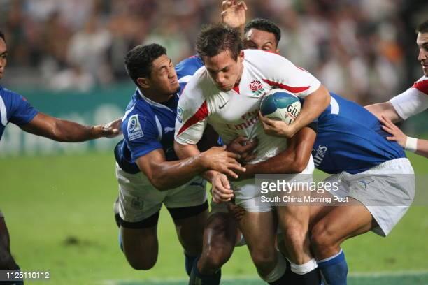 ONLY*** Samoa's Alafoti Faosiliva tackles England's Andy Vilk durin gSamoa vs England at the second day of the Hong Kong Rugby Sevens Hong Kong...