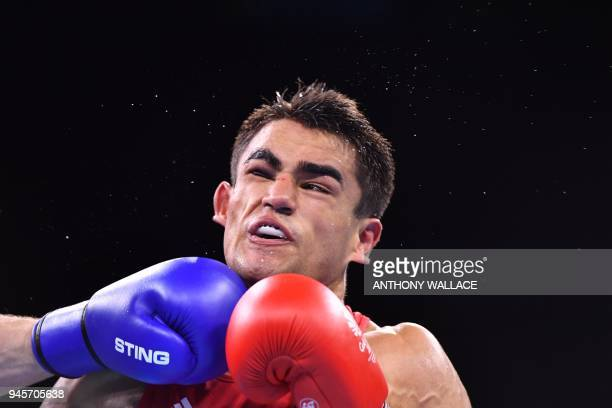 Samoa's Ato PlodzickiFaoagali is punched by Canada's Harley O'Reilly during their men's 81kg semifinal boxing match during the 2018 Gold Coast...
