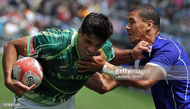 Samoa's Cornal Hendricks tackles South Africa's Petrus Engelbrecht during the Hong Kong Rugby Sevens tournament on March 25 2012 South Africa won...