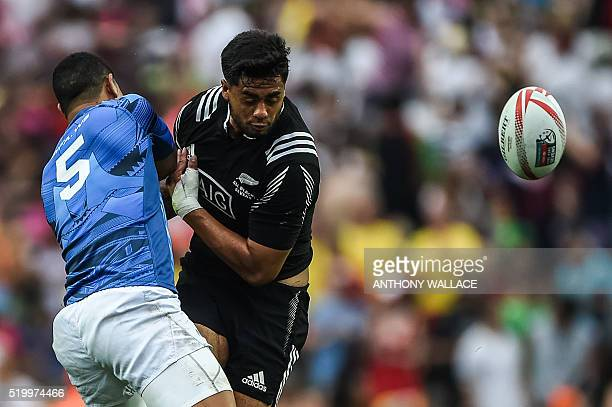 Samoa's Ed Fidow and New Zealand's Regan Ware collide as they jump during their match on the second day of the Hong Kong Rugby Sevens tournament on...