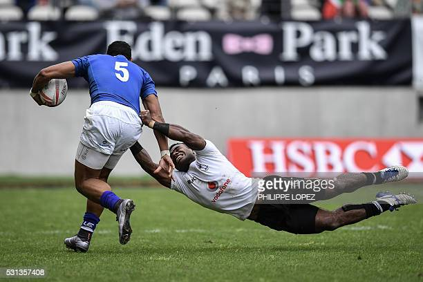 TOPSHOT Samoa's Ed Fidow is tackled by Fiji's Josua Tuisova during a HSBC Paris Sevens Series rugby match between Fiji and Samoa at the Stade Jean...