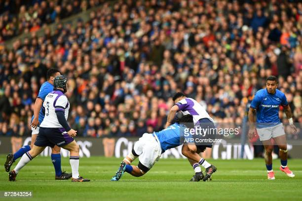 Samoa's flanker TJ Ioane tackles Scotland's prop Darryl Marfo during the autumn international rugby union test match between Scotland and Samoa at...
