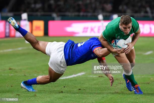Samoa's full back Tim NanaiWilliams tackles Ireland's full back Jordan Larmour during the Japan 2019 Rugby World Cup Pool A match between Ireland and...