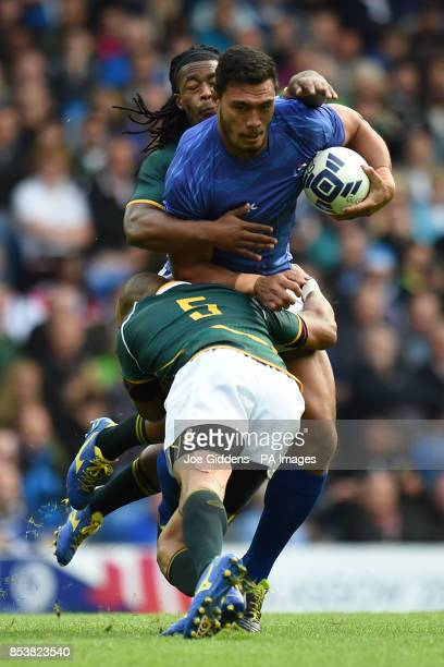 Samoa's Lio Lolo is tackled by South Africa's Cornal Hendricks and Cecil Afrika