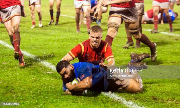 Samoa's Manu Leiataua scores a try in their rugby union Test match against Wales played in Apia on June 23 2017 / AFP PHOTO / SAMOA OBSERVER /...
