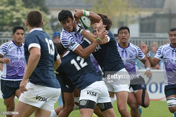 Samoa's Mathew Naoupu Elia is tackled by Argentina's centre Andres Speziali and wing Axel Muller during the IRB Under 20 Junior World Championship...