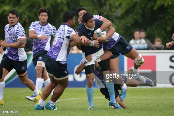 Samoa's Mathew Naoupu Elia tackles Argentina's wing Axel Muller during the IRB Under 20 Junior World Championship rugby match Argentina vs Samoa on...
