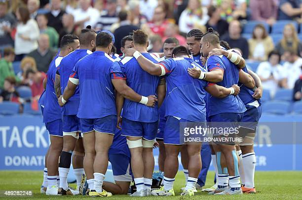 Samoa's players huddle prior to a Pool B match of the 2015 Rugby World Cup between Samoa and USA at the Brighton community stadium in Brighton south...