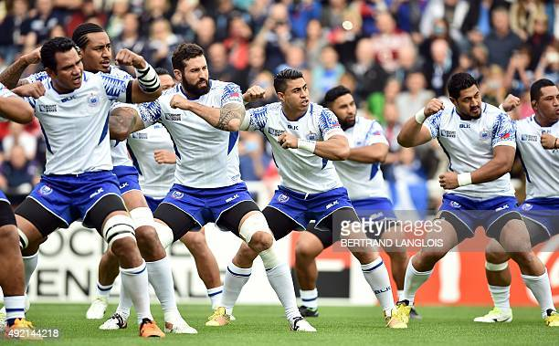Samoa's players perform their war dance prior to a Pool B match of the 2015 Rugby World Cup between Scotland and Samoa at St James' Park in...