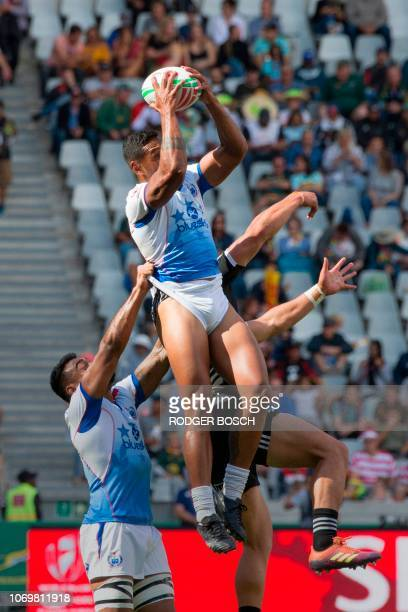 Samoa's Tomasi Alosio catches the ball in the lineout during the New Zealand vs Samoa group match on the first day of the Rugby Sevens tournament on...