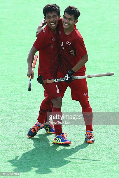 Samoethep Srilit and Chakan Boonmee of Thailand celebrate after winning the bronze medal match against Singapore during round 1 of the 2016 Hockey...