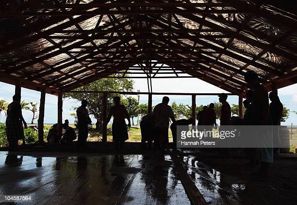 Samons build a new church on September 30 2010 in Saleapaga Samoa 189 people were killed and hundreds more injured in Samoa American Samoa and Tonga...