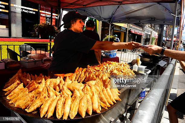 TORONTO ON AUGUST 10 Samosas and fries are sold at the Magic Oven at The 20th annual Taste of the Danforth festival is on this weekend from Friday to...