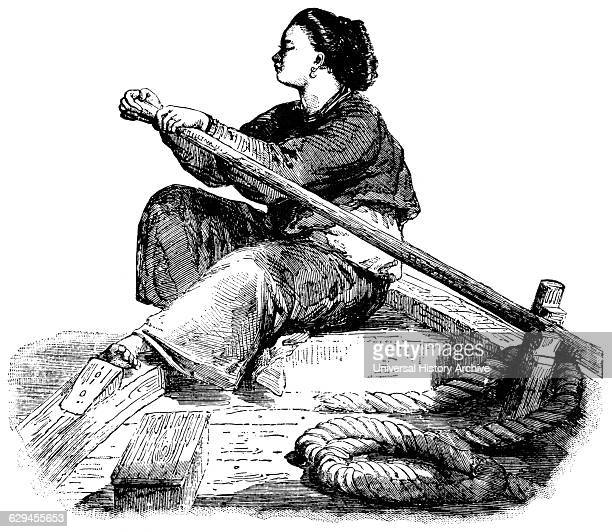 Sampan Girl Sitting Sideways in Bow of Vessel while Rowing on Canton River China 'Classical Portfolio of Primitive Carriers' by Marshall M Kirman...