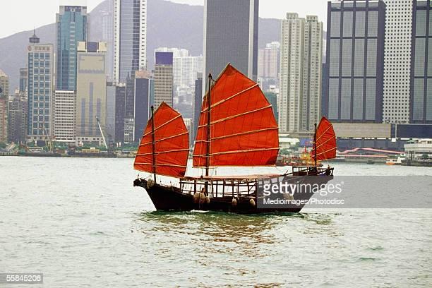 Sampan with red sails at Hong Kong Harbor, Hong Kong, China