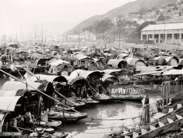 Sampans or houseboats moored at Kowloon, Hong Kong, circa 1920.