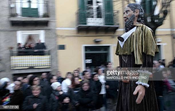 A Sampauluna giant statue is carried during the Easter procession on March 31 2013 in San Cataldo on the italian island of Sicily The giant...