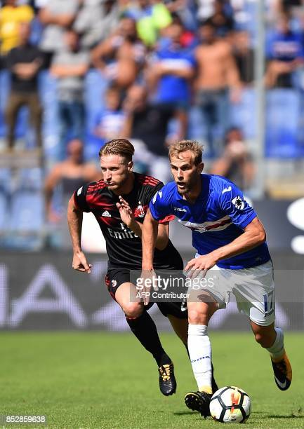 Sampdoria croatian defender Ivan Strinic vies with AC Milan' Italian defender Ignazio Abate during the italian Serie A football match between...