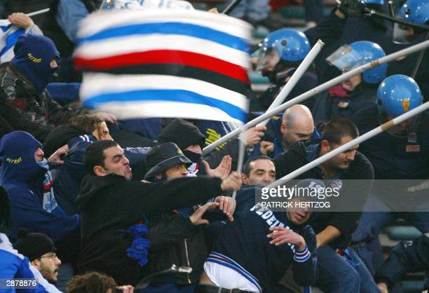 Sampdoria Genoa's fans clash with riot police during the Italian Serie A soccer match between AS Roma and Sampdoria at the Olympic stadium in Rome...
