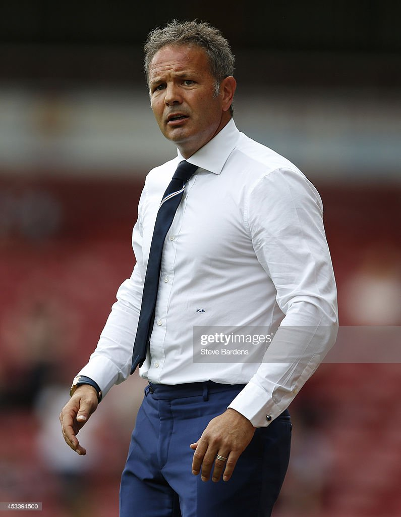 Sampdoria manager Sinisa Mihajlovic looks on during the pre-season friendly match between West Ham United and Sampdoria at Boleyn Ground on August 9, 2014 in London, England.