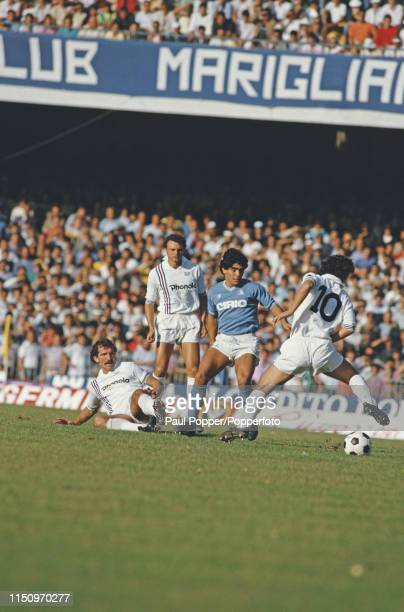 Sampdoria midfielder Graeme Souness pictured on the ground next to Napoli midfielder/forward Diego Maradona during play between Napoli and Sampdoria...