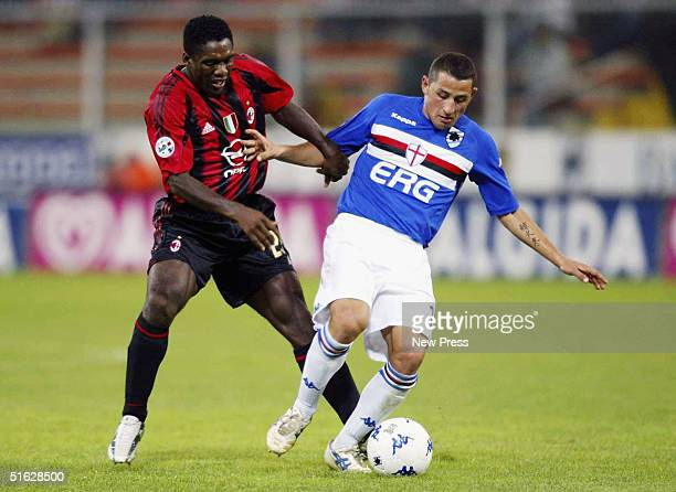 Sampdoria's Angelo Palombo avoids the challenge from Milan's Clarence Seedorf during the Italian Serie A match between Sampdoria and AC Milan at...